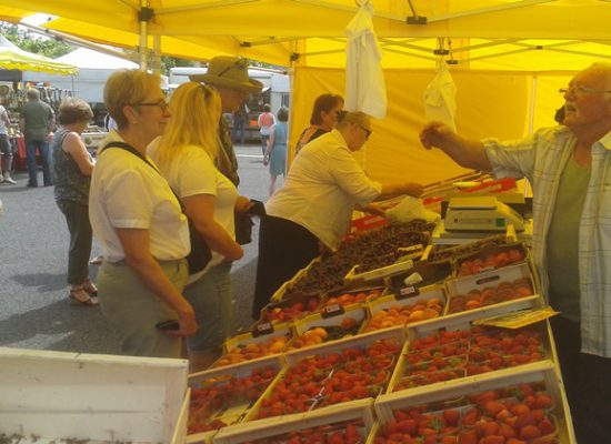Weekly market with fresh produce in Mur de Barrez